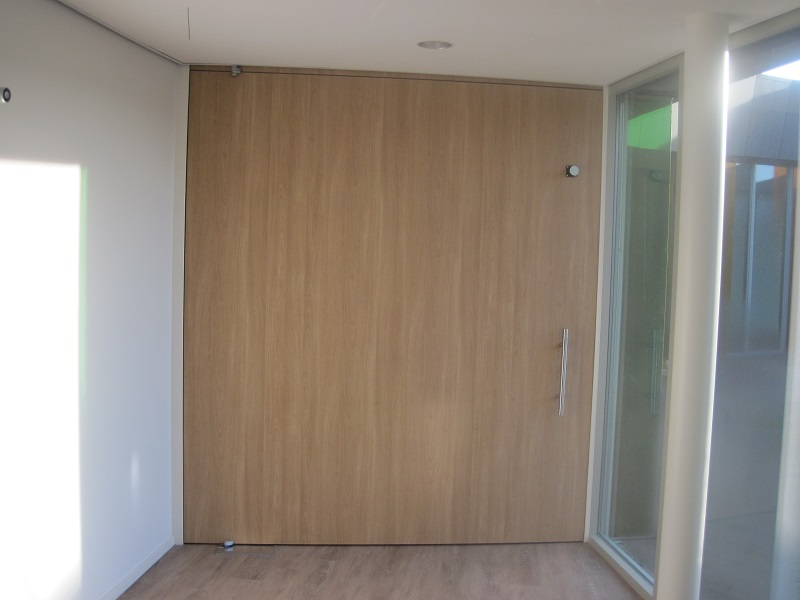 It is hard to identify the hinged pivot doors, because they have no frame.