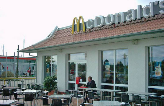Outdoor terrace at McDonald's – with access gate from the street
