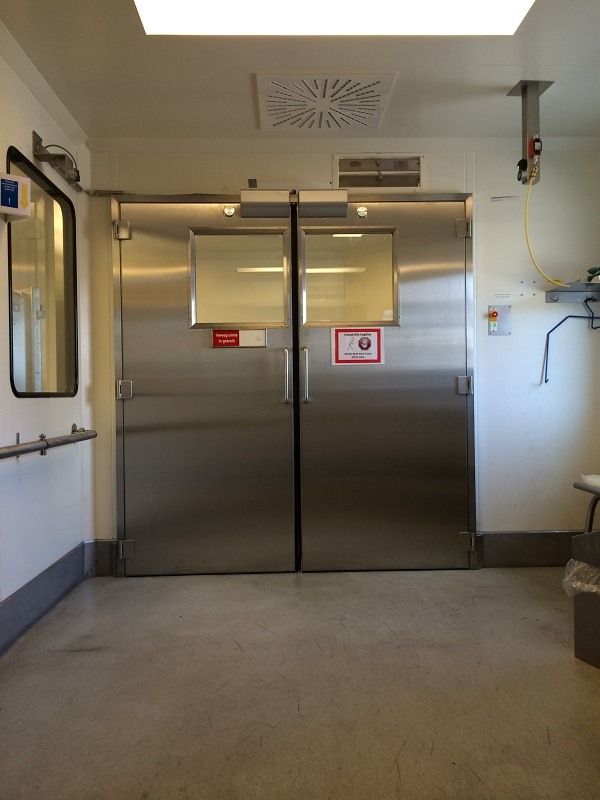 Interlock doors with door closers to remain open for material transportation